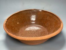 A 19th century Sussex terracotta basinCONDITION: General wear and surface scuffs, minor blisters