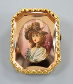A yellow metal mounted octagonal brooch, with oval painted bust of a lady in mirrored surround,