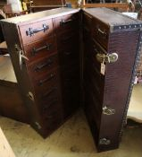 A Louis Vuitton style travel trunk, height 118cmCONDITION: This is a Chinese reproduction and nearly