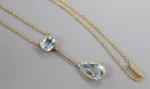 A yellow metal and two stone aquamarine drop pendant necklace, 25.5cm, gross 5.8 grams.CONDITION: