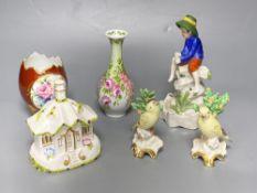 A Sitzendorf figure 'Fisher boy', a Coalport cottage and Continental ceramics (6)CONDITION: Good