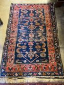 A Belouch blue ground rug, 172 x 110cmCONDITION: Some wear to the central field and also wear just