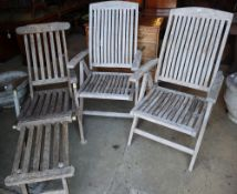 A pair of weathered teak folding garden chairs and a similar steamer chairCONDITION: All in