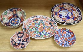 A Japanese Imari oval dish with six-character mark to base and six other items of Japanese Imari