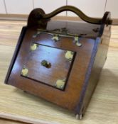 A Gothic revival walnut and brass mounted coal box on ceramic casters, 35cm wideCONDITION: The sides
