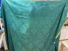 A mid-18th century joined coverlet of green silk damask, comprising three and half joined lengths