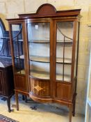 An Edwardian inlaid mahogany bow fronted china display cabinet, width 114cm height 191cmCONDITION: