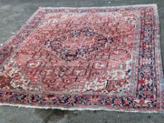 A large Persian red ground carpet, 444 x 347cmCONDITION: Looks to be in good condition, probably
