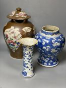 Two Chinese Kangxi period blue and white vases and a Qianlong Batavia vase and cover, largest 36cm