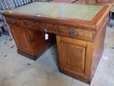 An early 20th century oak pedestal desk, width 136cmCONDITION: Top a little faded with a central