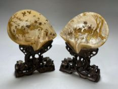 A pair of Chinese mother o'pearl dishes, gilt lacquered with figures and birds in landscapes, on