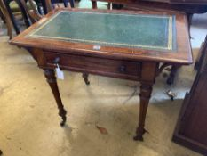 A late Victorian mahogany writing table, with leather lined top and ceramic castors, width