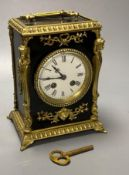 A French ebonised mantel clock with cast brass mounts, 9cm convex enamel dial, bell striking