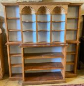 A pine breakfront open bookcase, width 172cm height 176cmCONDITION: Looks to have been made up