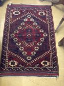 A North West Persian madder ground rug, 125 x 88cmCONDITION: Very good clean condition.