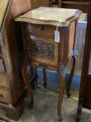 An Edwardian carved walnut bedside cabinet, with marble top and ceramic lined interior, width 41cm