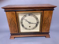 A mahogany mantel clock with ebonised decoration, by Elliott of London, width 33cm, height