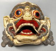 A Balinese carved and painted wood dragon mask, 28cmCONDITION: Generally good.