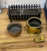 A wrought iron fire grate, two coal bowls and a pair of fire brassesCONDITION: All pieces would
