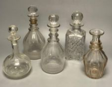 A pair of Regency glass mallet decanters with stoppers, 27cm and three other decanters (5)CONDITION: