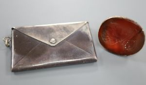 A 19th century yellow metal and carnelian set intaglio fob seal(a.f.) and an Edwardian silver double