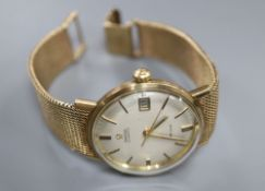 A gentleman's early 1970's 9ct gold Omega De Ville automatic wrist watch, on integral Omega 9ct gold