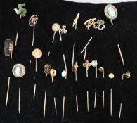 Twenty assorted Victorian and later mainly yellow metal and gem set stick pins, including diamond