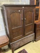 An 18th century oak press cupboard with base drawer, width 120cm height 169cmCONDITION: Overall
