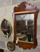 A George III style fret cut wall mirror and two others, tallest 102cmCONDITION: Main fret frame