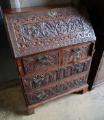 A small 18th century walnut bureau, later carved, width 76cm depth 47cm height 103cmCONDITION: