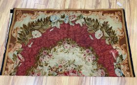 A 19th century Aubusson wall hanging, 154 x 174cmCONDITION: Small tear at central fold,