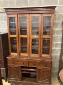 A Victorian mahogany bookcase cupboard, with pull out mid section writing slide, width 144cm depth