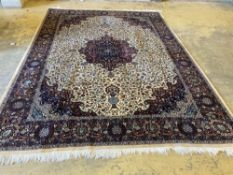 A large Persian cream ground carpet, 280 x 387cmCONDITION: Dirty in places, brown staining in one