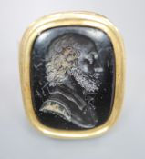 A 9ct and black onyx? intaglio ring, carved with the bust of a gentleman to sinister, size R/S,