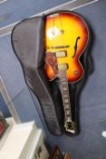 An Aria Career electric acoustic and jazz guitar, in soft case