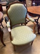 An Edwardian carved and stained beech fauteuil, width 58cmCONDITION: Frame a little wobbly,