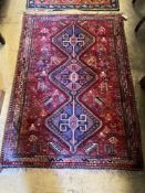 A Hamadan red ground rug, 157 x 109cmCONDITION: Good condition, some slight wear at the fringe