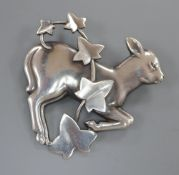 A Georg Jensen sterling 'Skipping Lamb' with ivy brooch, no. 311, 45mm.CONDITION: Overall