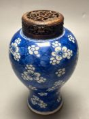 A Chinese blue and white vase, Kangxi period, wood cover, neck reduced, 18cmCONDITION: Crack