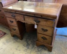 A walnut kneehole dressing table/desk, incorporating antique timbers, width 95cm height