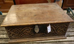A 17th century carved oak bible box, width 63cmCONDITION: Top with an old slightly slanted