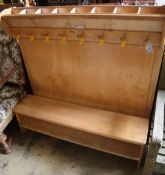 """A """"Community"""" furniture child's coat and shoe rack, length 125cm height 120cmCONDITION: Minor"""