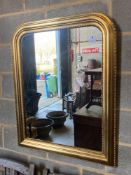A modern gilt frame arched wall mirror, width 80cm height 100cmCONDITION: Good clean condition