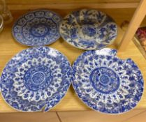 Four Chinese Kangxi period blue and white dishes and a Qianlong blue and white dishCONDITION: Pair