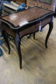 A 19th century French red boullework and ebony card table, with serpentine top, width 74cmCONDITION: