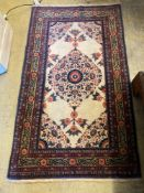 A North West Persian cream ground rug, 133 x 76cmCONDITION: Good condition with no faults noted.