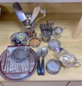 A quantity of plated items including coasters, flatware, cream jug, etc.CONDITION: Generally a bit
