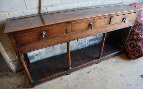 A Georgian oak three-drawer dresser base with potshelf, width 172cmCONDITION: Of good rich colour,