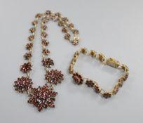 A 19th century gilt white metal and facet cut garnet set bracelet and similar necklace, 40cm.