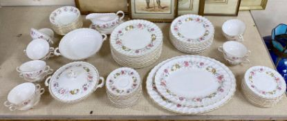 A Royal Doulton dinner service, 'Rosell' patternCONDITION: One tureen missing a cover. Otherwise